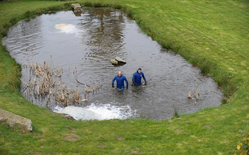 Gendarmes search in a pond ss part of the research for the Troadec family, missing since February 16 - Credit: AFP