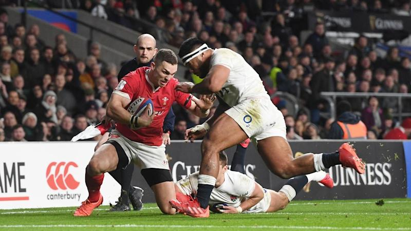 England's Manu Tuilagi was sent off for this tackle on Wales' George North at Twickenham