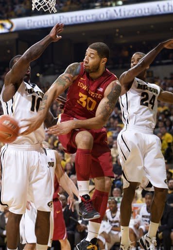 Iowa State's Royce White, center, passes the ball under the basket around Missouri's Ricardo Ratliffe, left, as Missouri's Kim English, right, defends during the first half of an NCAA college basketball game Wednesday, Feb. 29, 2012, in Columbia, Mo. (AP Photo/L.G. Patterson)