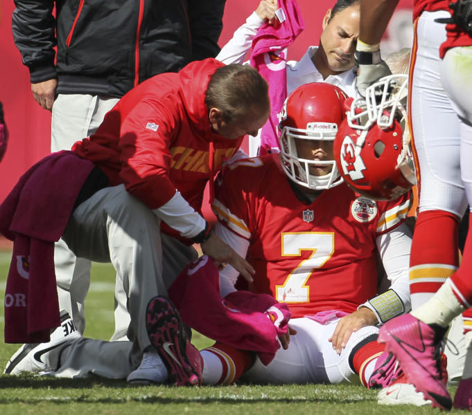 Trainers assist Kansas City Chiefs quarterback Matt Cassel (7) during the second half of an NFL football game against the Baltimore Ravens at Arrowhead Stadium in Kansas City, Mo., Sunday, Oct. 7, 2012. The Ravens defeated the Chiefs 9-6. (AP Photo/Colin E. Braley)