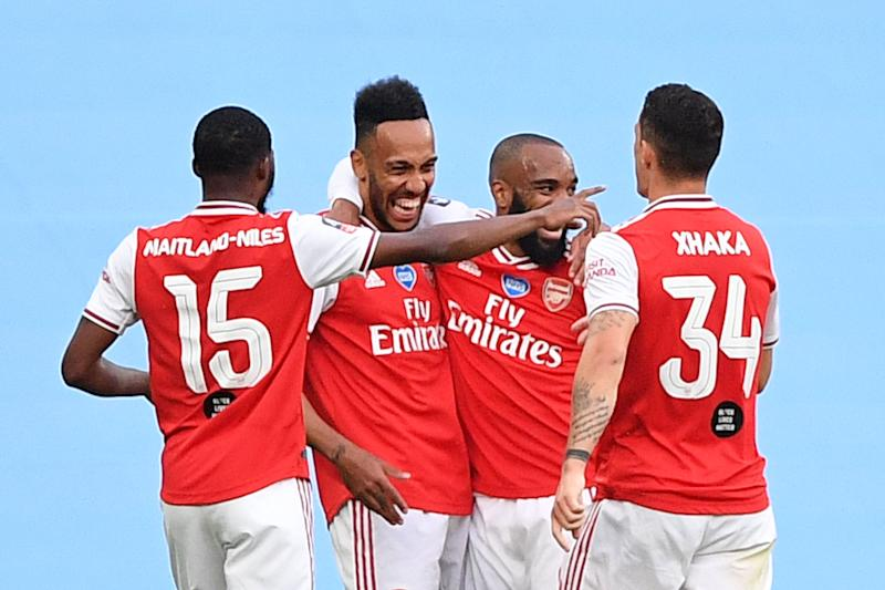 Arsenal's Gabonese striker Pierre-Emerick Aubameyang (2L) celebrates scoring the opening goal during the English FA Cup semi-final football match between Arsenal and Manchester City at Wembley Stadium in London, on July 18, 2020. (Photo by JUSTIN TALLIS / POOL / AFP) / NOT FOR MARKETING OR ADVERTISING USE / RESTRICTED TO EDITORIAL USE (Photo by JUSTIN TALLIS/POOL/AFP via Getty Images)