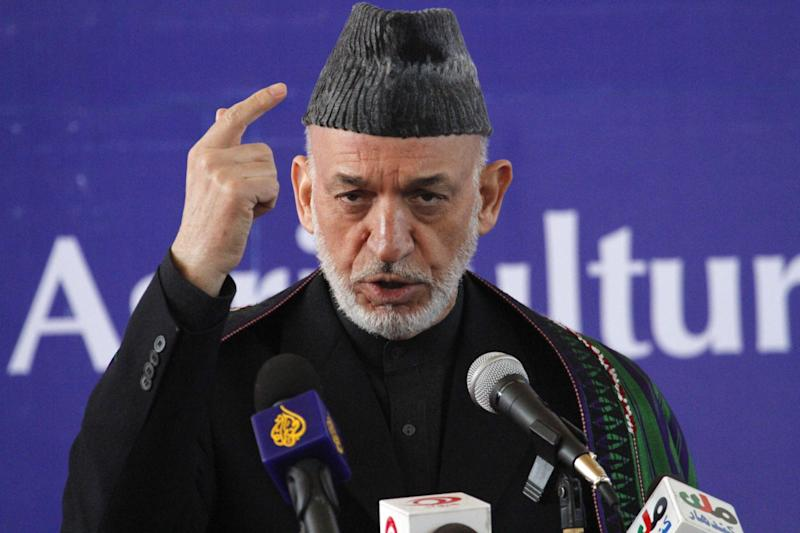 Afghan President Hamid Karzai speaks at the inauguration ceremony of the Afghan National Agriculture Science and Technology University accompanied by Indian Foreign Minister Salman Khurshid, in Kandahar province south of Kabul, Afghanistan, Saturday, Feb. 15, 2014. A total 4.5 million U.S. dollars has been spent by the government of India in building the university. (AP Photo/Allauddin Khan)