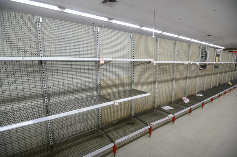 Picture of empty shelves due to panic buying at Coles