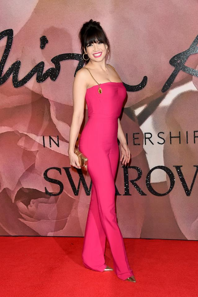 <p>You couldn't miss Daisy in a hot pink jumpsuit and bouffant hair. <i>[Photo: Getty]</i> </p>