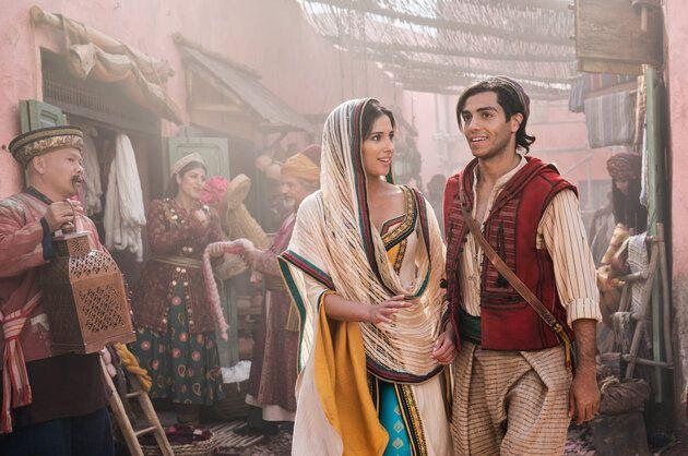Naomi Scott, as Jasmine and Mena Massoud as Aladdin on the mean streets of Agrabah.