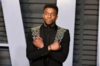 """<p>Chadwick Boseman was everywhere in 2018, thanks to his leading role in <em>Black Panther. </em>Here, he embodies his character with the """"Wakanda Forever"""" hand gesture on the red carpet. Sadly, Boseman passed away in 2020 after a secret battle with colon cancer.</p>"""