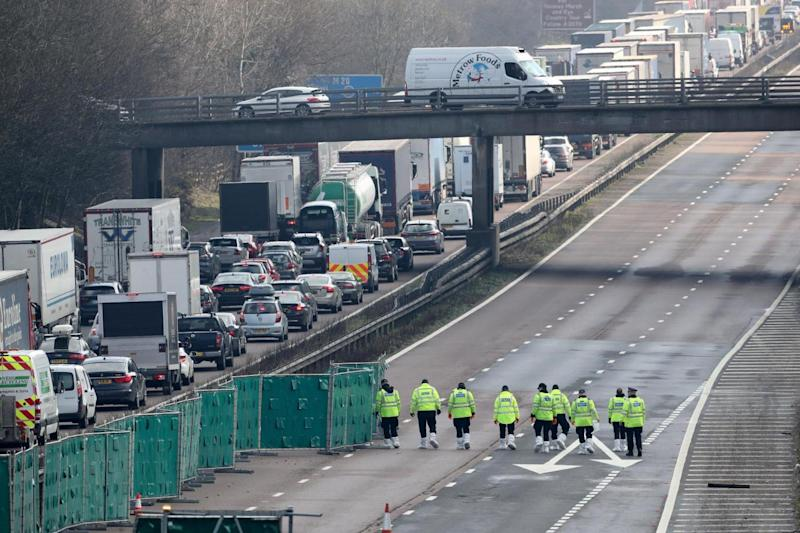 Police officers at work on the M20 near Ashford in Kent (PA)