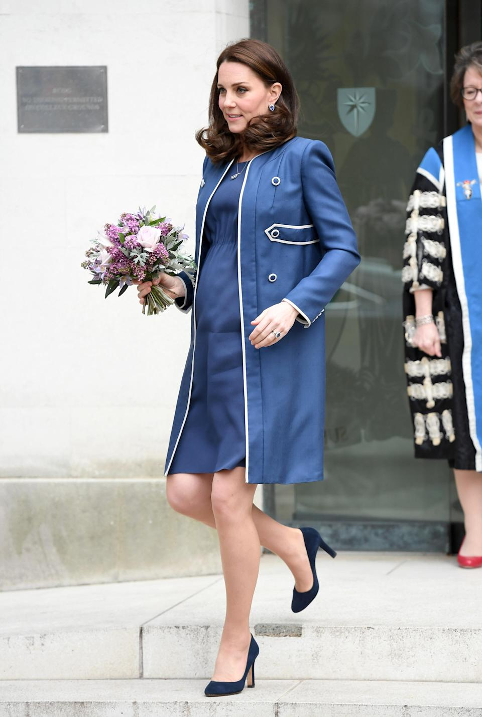 <p><strong>The occassion:</strong> Visiting the Royal College of Obstetricians and Gynaecologists in London.<br><strong>The look: </strong>A bespoke Jenny Packham coat over a matching dress, accessorised with a clutch, Jimmy Choo pumps, and sapphire jewels.<br>[Photo: Getty] </p>