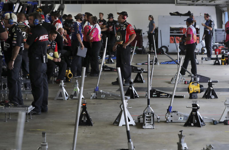 Teams monitor data and watch their racers on displays from their empty garages during a NASCAR Cup Series auto race practice at New Hampshire Motor Speedway in Loudon, N.H., Saturday, July 20, 2019. (AP Photo/Charles Krupa)