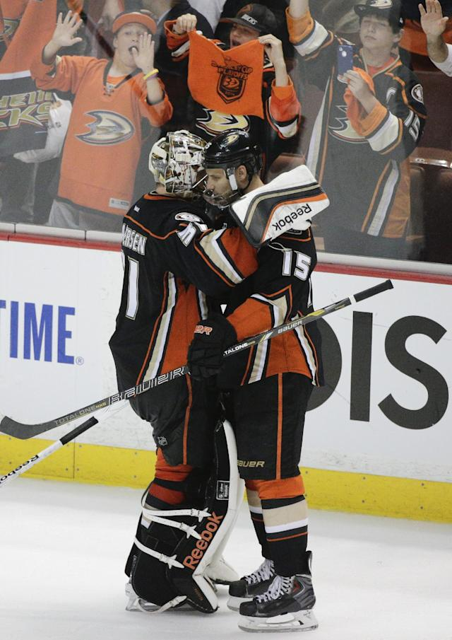 Anaheim Ducks' Ryan Getzlaf, right, and goalie Frederik Andersen, of Denmark, celebrate their team's 6-2 win against the Dallas Stars in Game 5 of the first-round NHL hockey Stanley Cup playoff series on Friday, April 25, 2014, in Anaheim, Calif. (AP Photo/Jae C. Hong)