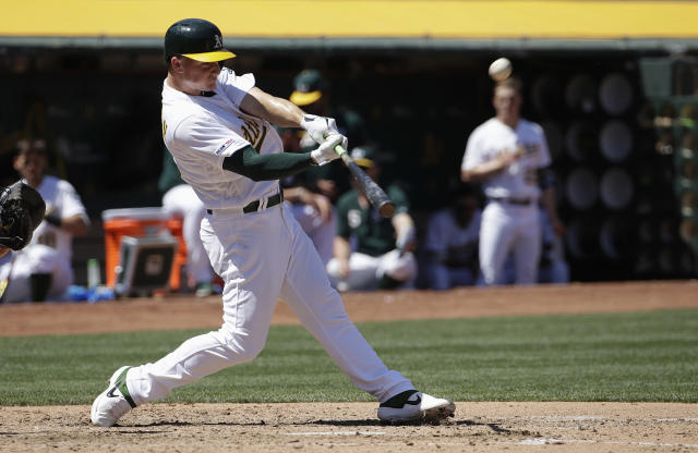 Oakland Athletics' Matt Chapman hits a solo home run against the Texas Rangers during the fifth inning of a baseball game in Oakland, Calif., Wednesday, April 24, 2019. (AP Photo/Jeff Chiu)