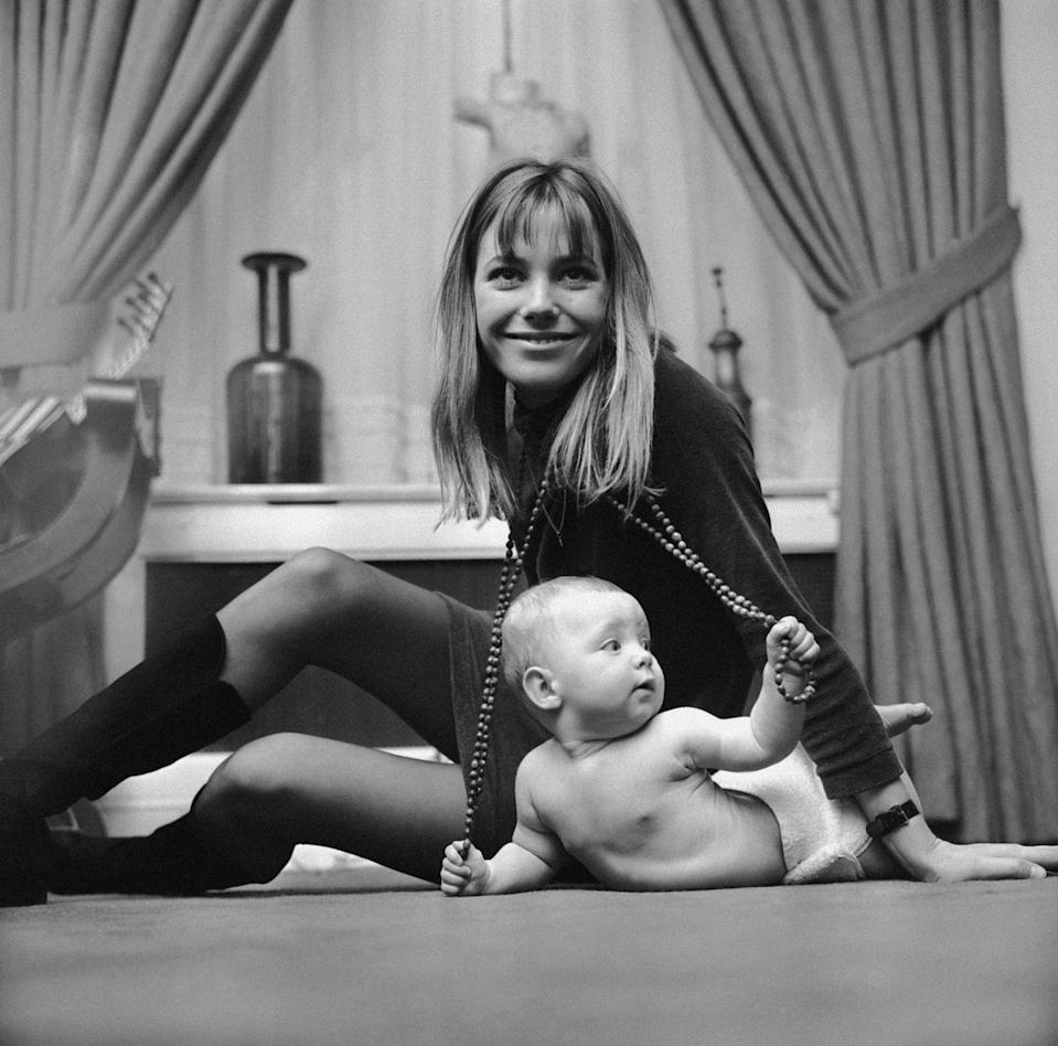 <p>Jane poses with her seven-month-old daughter, Kate Barry, in her London apartment in 1967. The actress and singer would divorce her husband, John Barry, a year later. </p>
