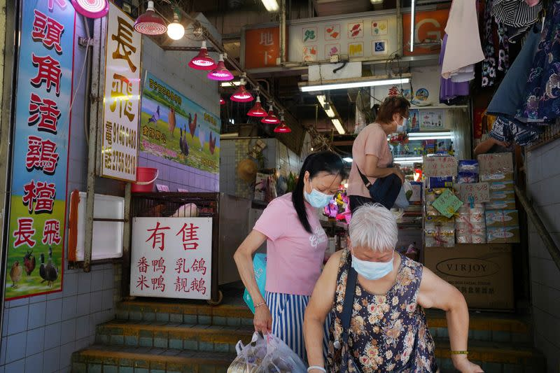 People are seen at a market in Hong Kong