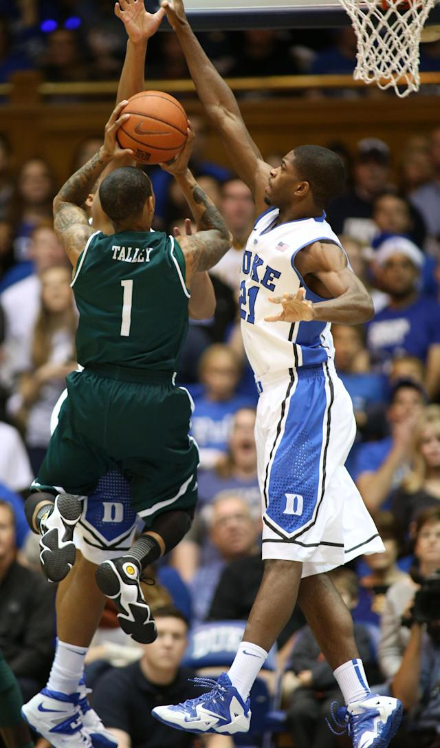 Eastern Michigan's Mike Talley (1) tries to shoot over the defense of Duke's Amile Jefferson (21) during the first half of an NCAA college basketball game in Durham, N.C., Saturday, Dec. 28, 2013. (AP Photo/Erik Perel)