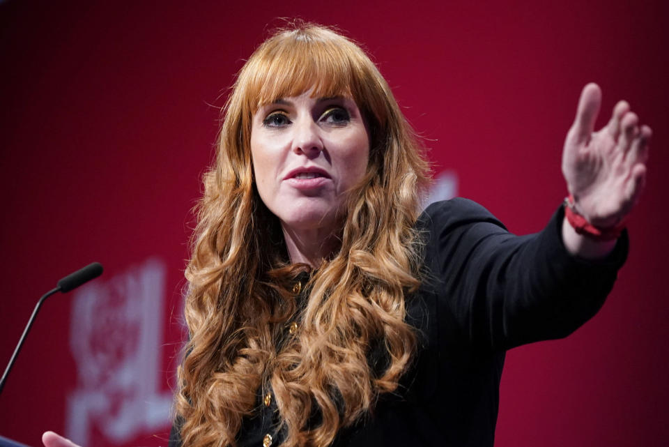 """Labour deputy leader Angela Rayner speaks at the Labour Party conference in Brighton, England, Saturday Sept. 25, 2021. The deputy leader of Britain's main opposition party is refusing to apologize for calling the governing Conservatives """"scum."""" Labour Party lawmaker Angela Rayner called members of the government a """"bunch of scum — homophobic, racist, misogynistic"""" during a reception at the party's annual conference on Saturday. (Stefan Rousseau/PA via AP)"""