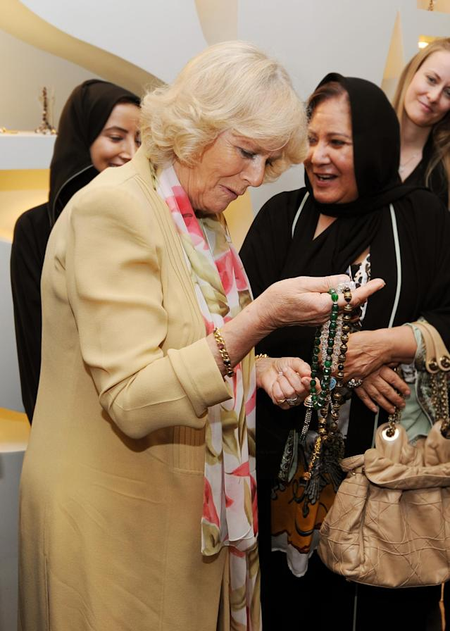 JEDDAH, SAUDI ARABIA - MARCH 17: Camilla, Duchess of Cornwall meets women who are learning jewellery art skills at the Bab Rizq Jameel Nafisa Shams Female Academy for Arts and Crafts on March 17, 2013 ,Jeddah, Saudi Arabia. (Photo by John Stillwell - Pool/Getty Images)