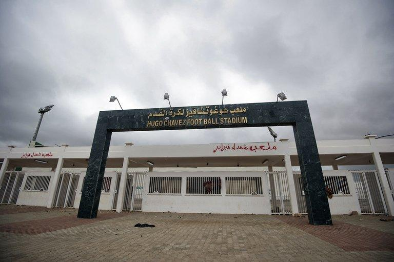 The main gate of a football stadium named after former Venezuelan President Hugo Chavez in Benghazi, March 8, 2011