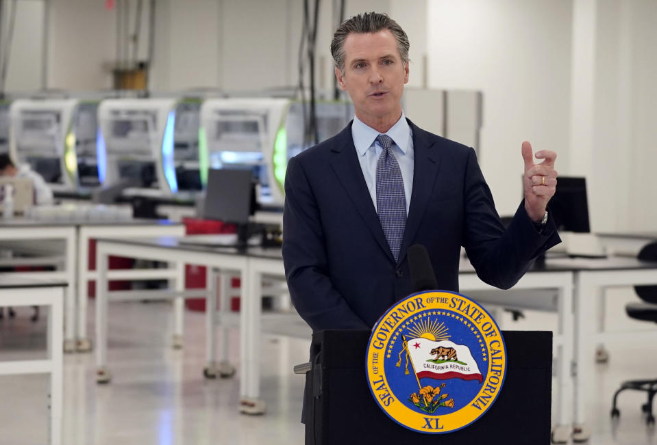 "FILE - In this Oct. 30, 2020, file photo, California Gov. Gavin Newsom speaks at a COVID-19 testing facility in Valencia, Calif. Newsom on Monday, Nov. 16, 2020, apologized for what he called ""a bad mistake"" in attending a birthday party that broke the very rules that he has been preaching to slow the spread of the coronavirus. (AP Photo/Marcio Jose Sanchez, Pool, File)"