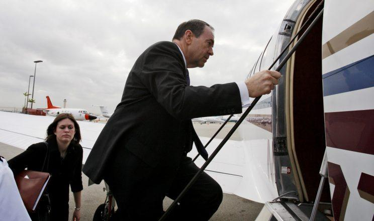 Republican presidential hopeful former Arkansas Gov. Mike Huckabee gets on his charter plane in Miami, Friday, Jan. 25, 2008, as he campaigns across Florida. At left is his daughter Sarah Huckabee. (AP Photo/Charles Dharapak)