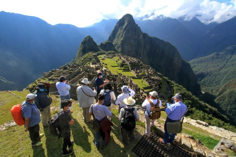 Members of a commission of authorities and experts led by the the Governor of Cusco, Jean Paul Benavente, visit the Inca citadel of Machu Picchu on June 12, 2020