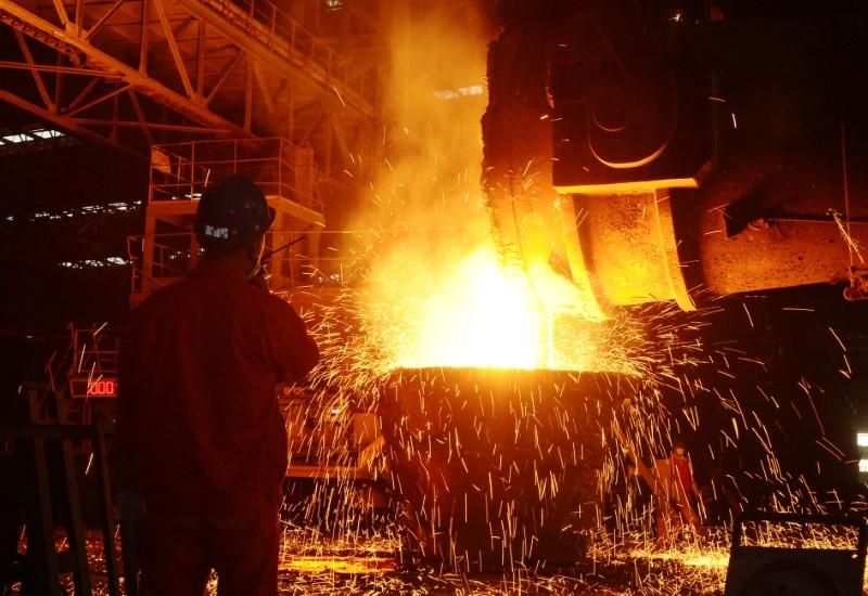 An employee works at a steel factory in Dalian