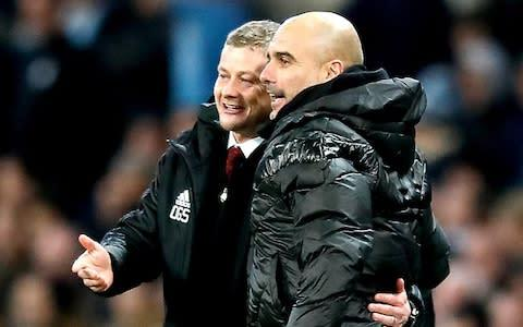 <span>Despite the tension the two mangers get touchy feely on the touchline</span> <span>Credit: PA </span>