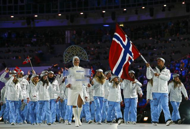 Norway's flag-bearer Aksel Lund Svindal leads his country's contingent during the opening ceremony of the 2014 Sochi Winter Olympic Games at Fisht stadium February 7, 2014. REUTERS/Brian Snyder (RUSSIA - Tags: OLYMPICS SPORT)