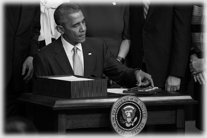 President Barack Obama signs the 21st Century Cures Act. The legislation eased the development and approval of experimental treatments and reformed federal policy on mental health care. (Photo: Cheriss May/NurPhoto via Getty Images)