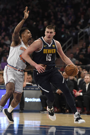 NEW YORK, NEW YORK - MARCH 22: Nikola Jokic #15 of the Denver Nuggets dribbles the ball against Lance Thomas #42 of the New York Knicks during the first half of the game at Madison Square Garden on March 22, 2019 in New York City. (Photo by Sarah Stier/Getty Images)