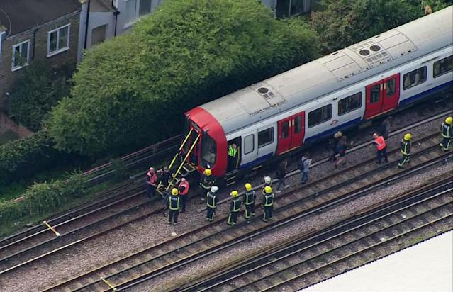 <p>In this aerial image made from video, emergency workers help people to disembark a train near the Parsons Green Underground Station after an explosion in London Friday, Sept. 15, 2017. (Photo: Pool via AP) </p>