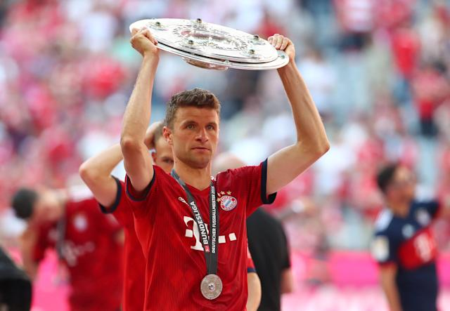 Soccer Football - Bundesliga - Bayern Munich v VfB Stuttgart - Allianz Arena, Munich, Germany - May 12, 2018 Bayern Munich's Thomas Mueller celebrates winning the Bundesliga with the trophy REUTERS/Michael Dalder DFL RULES TO LIMIT THE ONLINE USAGE DURING MATCH TIME TO 15 PICTURES PER GAME. IMAGE SEQUENCES TO SIMULATE VIDEO IS NOT ALLOWED AT ANY TIME. FOR FURTHER QUERIES PLEASE CONTACT DFL DIRECTLY AT + 49 69 650050