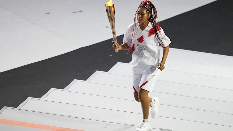 Naomi Osaka, pictured here carrying the Olympic torch during the Opening Ceremony.