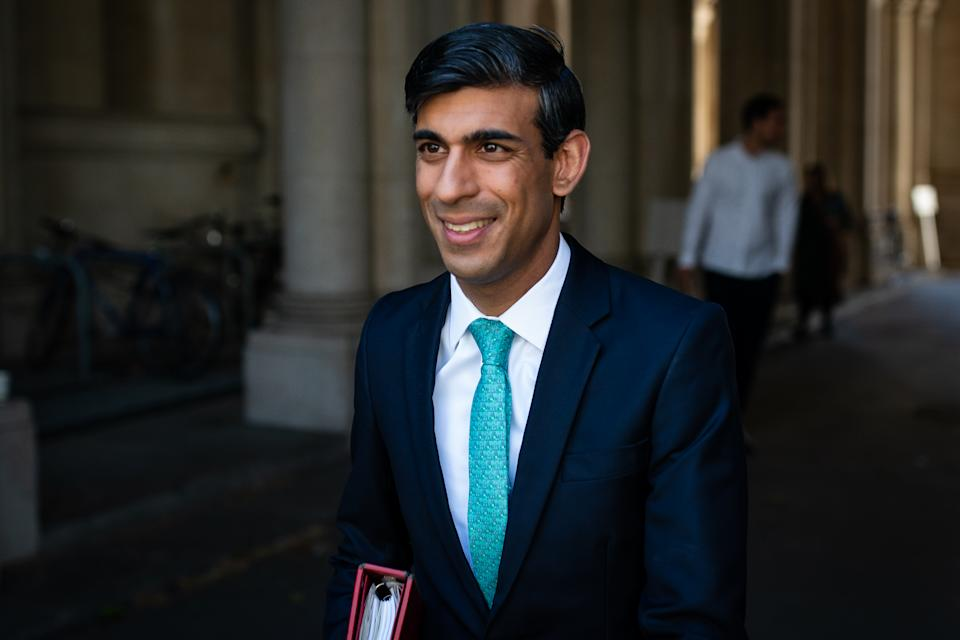 Chancellor of the Exchequer Rishi Sunak walks through from the foreign office to Downing Street after the introduction of measures to bring the country out of lockdown. (Photo by Aaron Chown/PA Images via Getty Images)