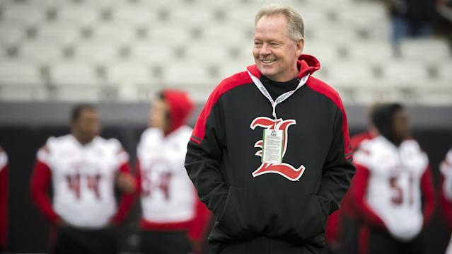 Louisville Cardinals head coach Bobby Petrino watches his team warm up before the start of the TaxSlayer Bowl NCAA college football game against the Mississippi State Bulldogs, Saturday, Dec. 30, 2017, in Jacksonville, Fla. (AP Photo/Stephen B. Morton)