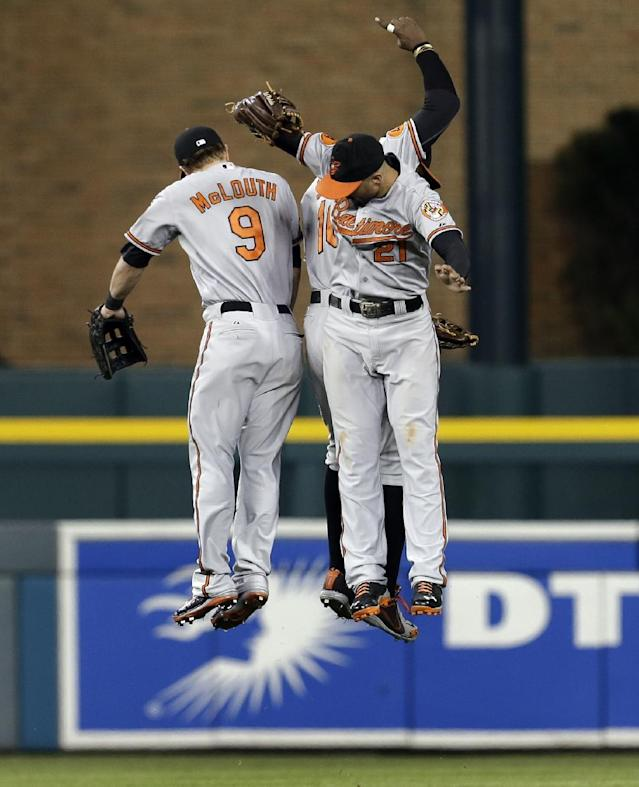 Baltimore Orioles outfielders Nate McLouth (9), Adam Jones (10) and Nick Markakis (21) celebrate their 5-2 win over the Detroit Tigers in a baseball game in Detroit, Tuesday, June 18, 2013. (AP Photo/Paul Sancya)
