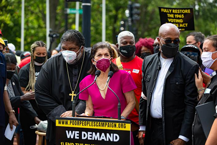 WASHINGTON DC — Luci Baines Johnson stands with Reverend Doctor William Barber at a rally this week in D.C., where protestors urged the US Senate to end the filibuster, protect voting rights, and raise the federal minimum wage to $15 an hour. / Credit: Michael Nigro/Pacific Press/LightRocket via Getty Images