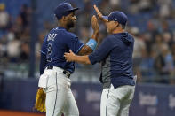 Tampa Bay Rays' Yandy Diaz (2) celebrates with manager Kevin Cash after the Rays defeated the Toronto Blue Jays during a baseball game Wednesday, Sept. 22, 2021, in St. Petersburg, Fla. (AP Photo/Chris O'Meara)