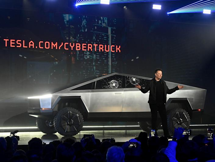 FILE PHOTO: Nov 21, 2019;  Hawthorne, CA, U.S.A; Tesla CEO Elon Musk unveils the Cybertruck at the TeslaDesign Studio in Hawthorne, Calif. The cracked window glass occurred during a demonstration on the strength of the glass.  Mandatory Credit: Robert Hanashiro-USA TODAY