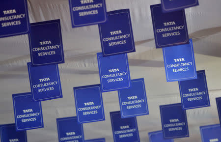 FILE PHOTO: Logos of Tata Consultancy Services (TCS) are displayed at the venue of the annual general meeting of the software services provider in Mumbai, June 29, 2012. REUTERS/Vivek Prakash