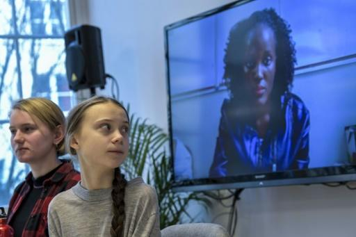 Greta Thunburg watches fellow eco warrior Vanessa Nakate, speaking from Kampala, after she was cropped out of a photo of young activists