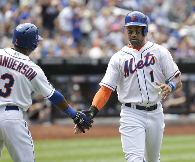 New York Mets' Chris Young, right, celebrates with Curtis Granderson after scoring on a single hit by Jacob deGrom in the fourth inning of the baseball game at Citi Field, Sunday, July 13, 2014 in New York. (AP Photo/Seth Wenig)