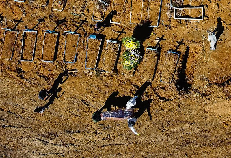 Aerial view showing a coffin being taken to its grave at the Nossa Senhora Aparecida cemetery in the neighbourhood of Taruma, in Manaus, Brazil, on June 2, 2020 during the COVID-19 novel coronavirus pandemic. - The pandemic has killed at least 375,555 people worldwide since it surfaced in China late last year, according to an AFP tally at 1100 GMT on Tuesday, based on official sources. Brazil is the fourth worst-hit country with 29,937 deaths so far. (Photo by Michael DANTAS / AFP) (Photo by MICHAEL DANTAS/AFP via Getty Images)
