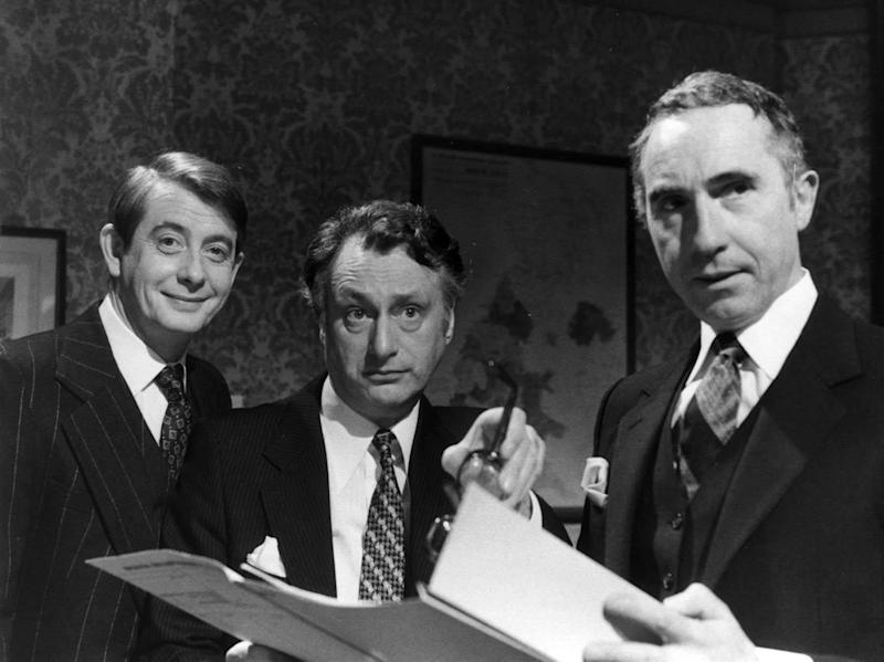 Fowlds (left) with Sir Nigel Hawthorne and Paul Eddington in Yes Minister (PA)