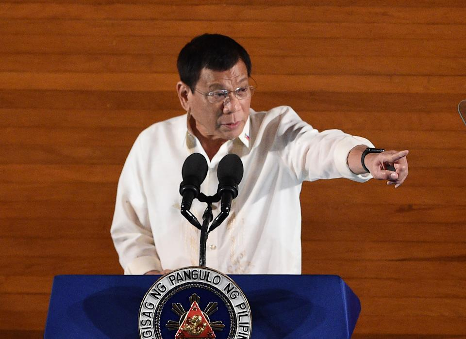 Philippine President Rodrigo Duterte gestures as he delivers his State of the Nation Address at Congress in Manila on July 25, 2016. Duterte announced a unilateral ceasefire with communist rebels who are waging one of Asia's longest insurgencies, and urged them to reciprocate. / AFP PHOTO / TED ALJIBE        (Photo credit should read TED ALJIBE/AFP via Getty Images)