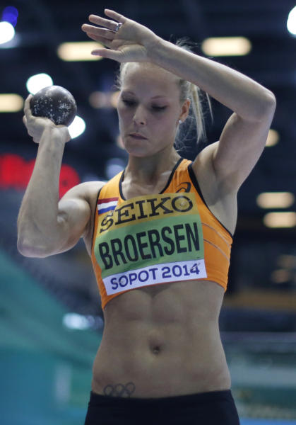 Netherlands' Nadine Broersen holds the shot before making an attempt in the shot put of the women's pentathlon during the Athletics Indoor World Championships in Sopot, Poland, Friday, March 7, 2014. (AP Photo/Matt Dunham)