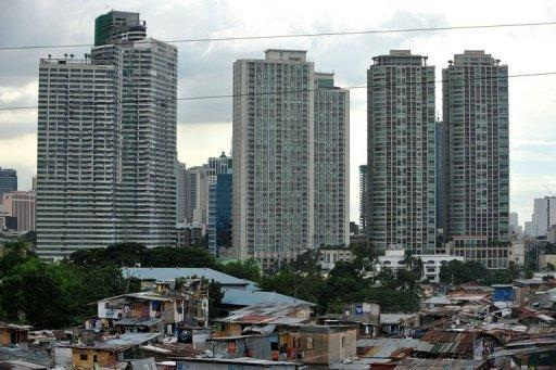 A sprawling shanty-town contrasts with high rise office buildings in the background in Makati, the financial district of Manila, in 2010. The United Nations on Thursday called for a tax on billionaires to help raise more than $400 billion a year for poor countries.