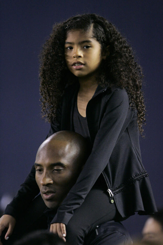 Los Angeles Laker Kobe Bryant stands on the sideline with his daughter Gianna Maria-Onore Bryant on his shoulders prior to the start of the game against the United States and China during an international firendly match at Qualcomm Stadium on April 10, 2014 in San Diego, California. (Photo by Kent C. Horner/Getty Images)
