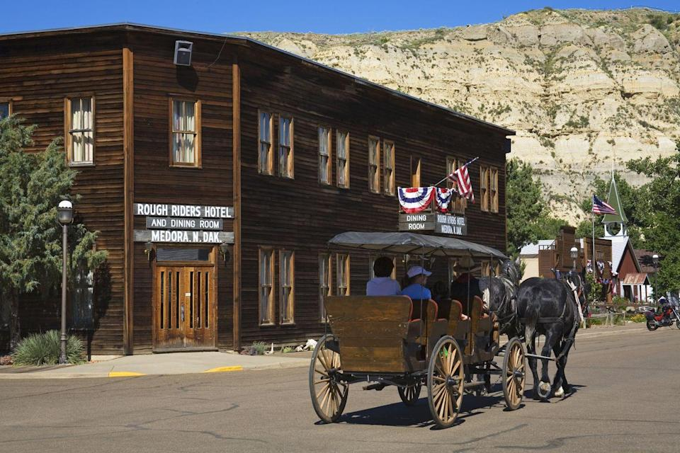 """<p>Named for the cavalry unit led by President <a href=""""http://medora.com/do/entertainment/a-teddy-roosevelt-salute-to-medora-the-national-parks/"""" rel=""""nofollow noopener"""" target=""""_blank"""" data-ylk=""""slk:Theodore Roosevelt"""" class=""""link rapid-noclick-resp"""">Theodore Roosevelt</a>, the Rough Riders Hotel is reported to have a youthful guest of honor. Visitors have claimed to hear a little boy laughing at his own juvenile hijinks, including flushing toilets when no one is in the bathroom.<br></p><p> <a class=""""link rapid-noclick-resp"""" href=""""https://go.redirectingat.com?id=74968X1596630&url=https%3A%2F%2Fwww.tripadvisor.com%2FHotel_Review-g60973-d144779-Reviews-Rough_Riders_Hotel-Medora_North_Dakota.html&sref=https%3A%2F%2Fwww.countryliving.com%2Flife%2Ftravel%2Fg2689%2Fmost-haunted-hotels-in-america%2F"""" rel=""""nofollow noopener"""" target=""""_blank"""" data-ylk=""""slk:PLAN YOUR TRIP"""">PLAN YOUR TRIP</a></p>"""