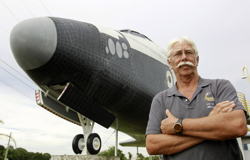 In this Wednesday, July 11, 2012 photo, former space shuttle worker Terry White poses in front of a mock space shuttle at the Astronaut Hall of Fame in Titusville, Fla. White was a project manager who worked 33 years for the shuttle program until he was laid off after Atlantis landed last July 21. (AP Photo/John Raoux)