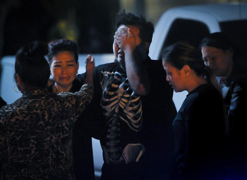 People are seen in the aftermath of a shooting Sunday evening in Fresno, California, that left four people dead. (Photo: Fresno Bee via Getty Images)